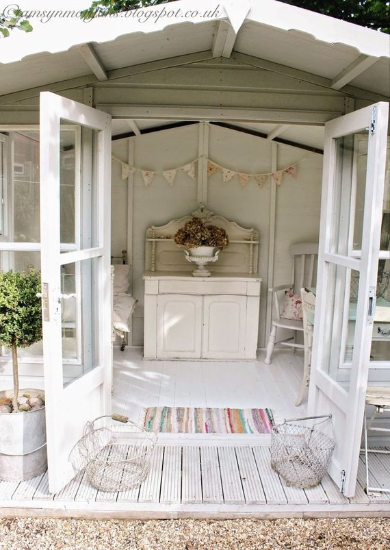 Cream Shabby Chic Shed with bunting and distressed detailing