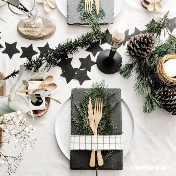 Christmas Place setting with slate Stars and Baby's breath floral arrangement and candles